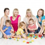 Children Group with Mothers Playing Toy Blocks. Little Kids Early Development. Baby Active Games, Isolated Over White Background