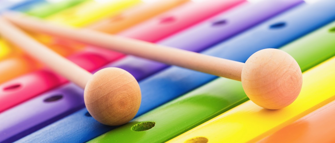 Rainbow colored wooden toy xylophone isolated on white background